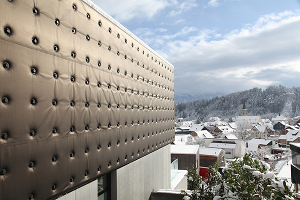 Image of  rubber sheeting and architectural carpeting as sustainable facade materials.