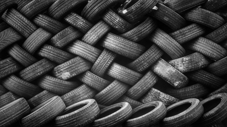 Pile of Rubber Automotive Tyres in An Industry
